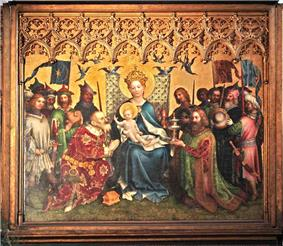 Rectangular central section of an altarpiece in the International Gothic style, showing the Three Kings adoring the Christ Child. The arrangement is formal, balanced and intricately detailed. The Virgin Mary, in a robe of brilliant blue sits enthroned with Jesus on her knee at the center of the painting. The figures have a sweet, doll-like quality. On either side kneel the two older kings clothed in robes of patterned velvet, one green and the other crimson, with gifts of a golden box and a silver chalice. The youngest king stands behind one of the kneeling figures, and presents a container of semi-precious stone.