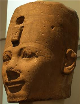 A stone head, most likely depicting Thutmose I, at the British Museum