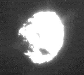 An overexposed image of Wild 2 showing plumes of material coming from the surface