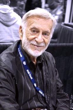 Smiling, bearded white-haired man