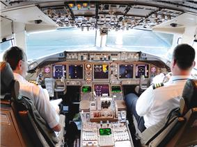 A cockpit of the 767, with multiple liquid crystal display monitors.