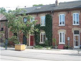 A group of houses along Queen Street in Corktown