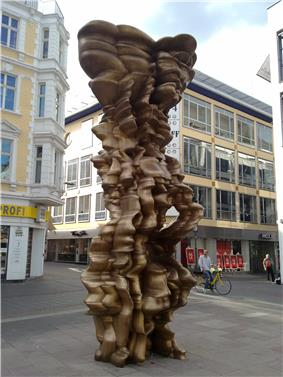 a tall windswept-looking abstract sculpture