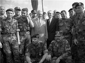 Franjo Tuđman and several Croatian Army officers at a photo op