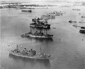 Aerial photo of target ships anchored in a row at Pearl Harbor, Hawaii.