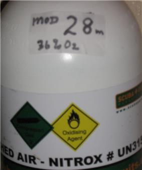 Closeup of a diving cylinder with a band reading