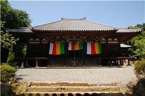 Wooden building with raised floor and a wide staircase.