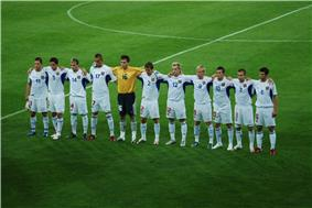 The team standing together before a match.