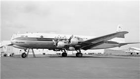 A black-and-white photograph of a JAL Douglas DC-6
