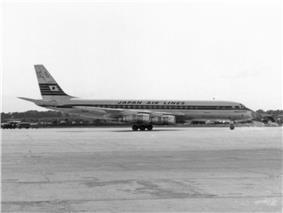A black-and-white photograph of a Douglas DC-8 aircraft on the tarmac