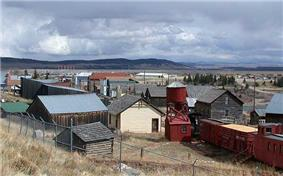 View of Fairplay and South Park looking south from State Highway 9. The historic buildings of South Park City, an open-air museum, are in the foreground.