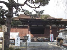 Wooden building with a step canopy.