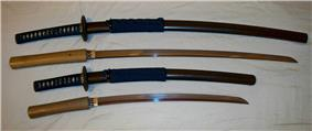 Antique Japanese (samurai) daishō, the traditional pairing of two Japanese swords which were the symbol of the samurai, showing the traditional Japanese sword cases (koshirae) and the difference in size between the katana (top) and the smaller wakizashi (bottom).
