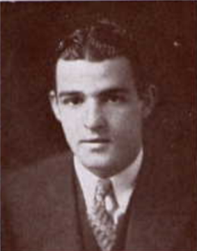 Head-and-shoulders shot of Van Sickel in suit jacket and tie