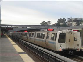 A BART train boarding passengers at the Daly City Station