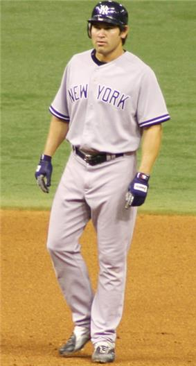 A man in a gray baseball uniform with