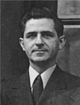 Black and White head and shoulder shot of 30's white male with thick black hair, and a three piece suit from the 1940s