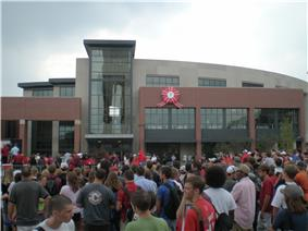 New building with students gathered for dedication ceremony