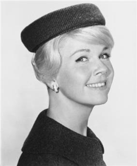 Actress Doris Day wearing a pillbox hat in 1960