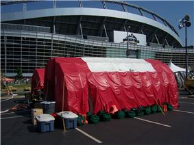 Decontamination tents in front of INVESCO Field.jpg