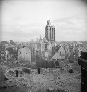 A scenic cityscape showing destroyed and badly-damaged buildings