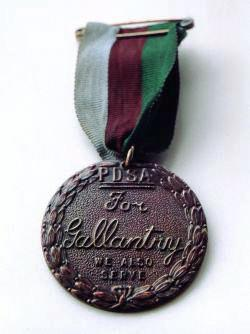 Bronze medal encircled in a laurel wreath and inscribed