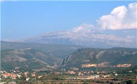 Picture of large mountain with about 30-degree sloped sides