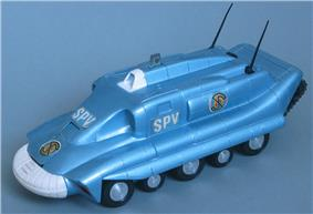 The photograph depicts a scale toy replica of an armoured tank-like vehicle that is metallic-blue in colour, with five wheels on each side.
