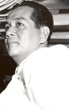 A black-and-white photograph of a middle-aged Filipino male, looking distantly toward the left of the image