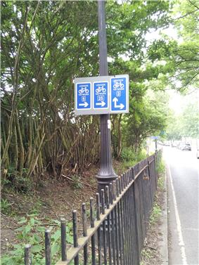 Direction signs for multiple London Cycle Network routes.