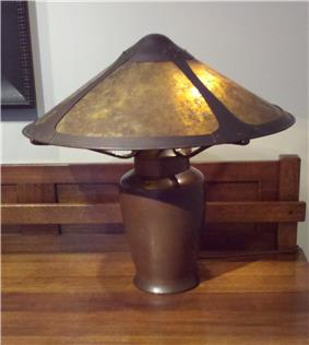Photo of a copper lamp designed by Dirk Van Erp