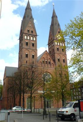 A red brick building, with two towers