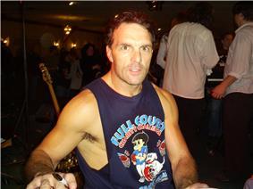 A picture of Doug Flutie posing.