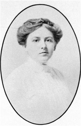 A small formal portrait photograph of Douglas in her early twenties. She has a round face, short nose and dark intelligent eyes. Her dark hair is parted at the centre and piled on her head.