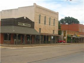 A view of Claude on U.S. Highway 287, with historic pharmacy building on the left.