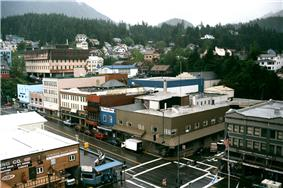 View from a cruise ship of downtown Ketchikan in May 2002.  In the foreground is the intersection of Dock and Front streets.  The Tongass Trading Company, which anchors the intersection, has operated in Ketchikan since 1898. It is very famous for its fishing.}}