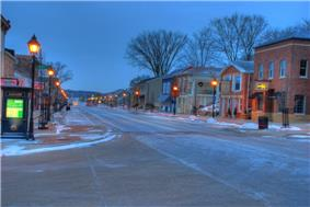 Dawn in Downtown Le Claire by Burt Gearhart