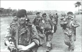 Belgian soldiers, wearing berets and camouflaged jackets