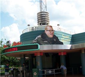 Larger than life figure of Carey's head and shoulders, posted above the studio entrance.