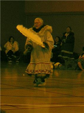 Female dancer in costume performing in front of an audience