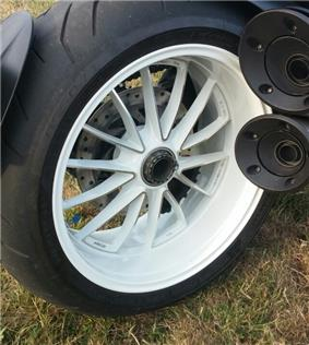 White rear wheel of a Ducati Diavel mounted to a single sided swingarm