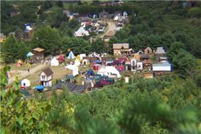 A small town constructed in a medieval style, surrounded by forest