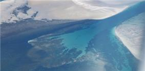 A river flowing into the ocean forming a small delta