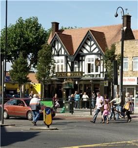 Hanwell Broadway showing the Coronation clock tower, with the Duke of York public house to the left of the image.