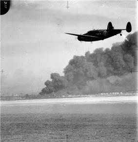 A Hudson of 220 Sqn over the Dunkirk beaches during the British evacuation, 1940.