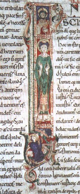 Illuminated manuscript illustration of a capital letter. At the top, there is a small box containing a man's head circled by a halo. The middle section is a long box containing a full length figure of a man carrying a crozier and wearing bishop's robes. At the bottom is a small box containing a kneeling man with a tonsure staring upwards at the full length figure.