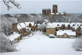 A picture of Durham School chapel in the snow with Durham Cathedral in the background