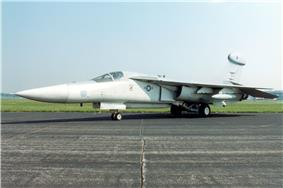 Jet aircraft with pointed nose parked on ramp.