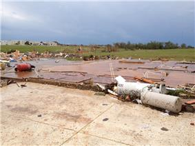 EF5 damage example -- Well-built house is swept completely away, leaving only the slab foundation