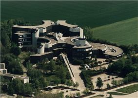 Aerial view of large, landscaped complex of buildings